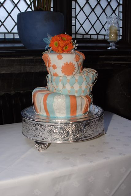Orange and Teal wedding cake Purple Cake