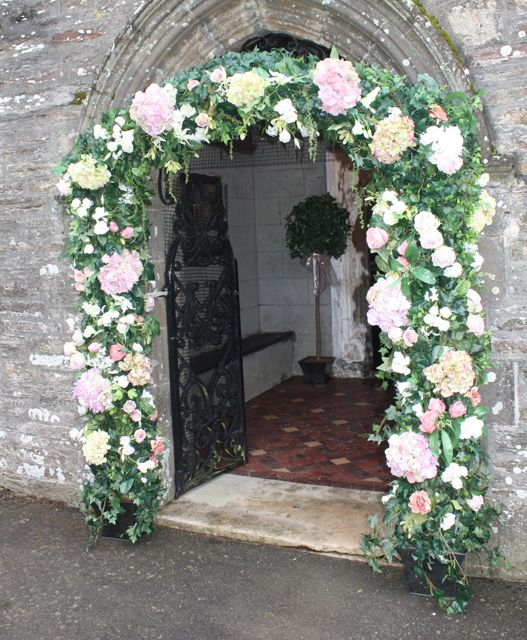 Pink Wedding Arch All of our arrangements are bespoke design made up for