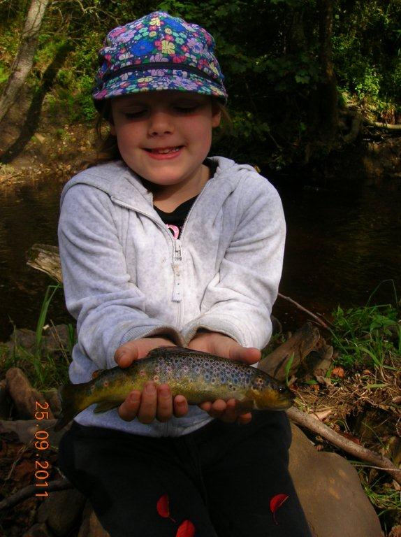 Lucy holding wild brown trout
