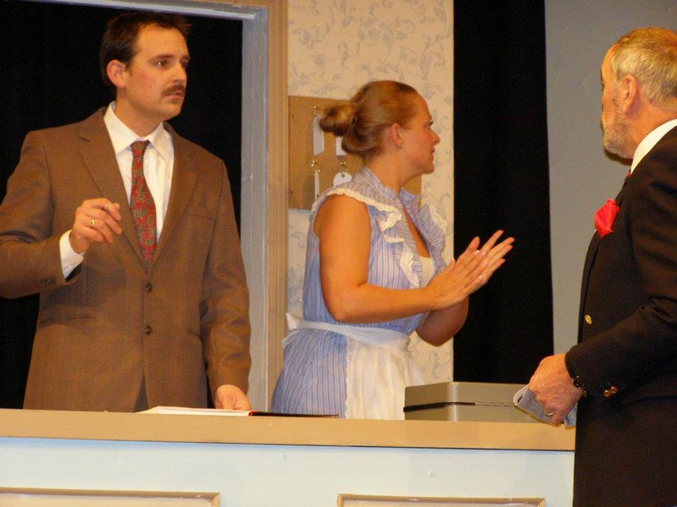 Mark Thomas, Shelley Bethan Morgan and Graham J. Evans in Fawlty Towers.