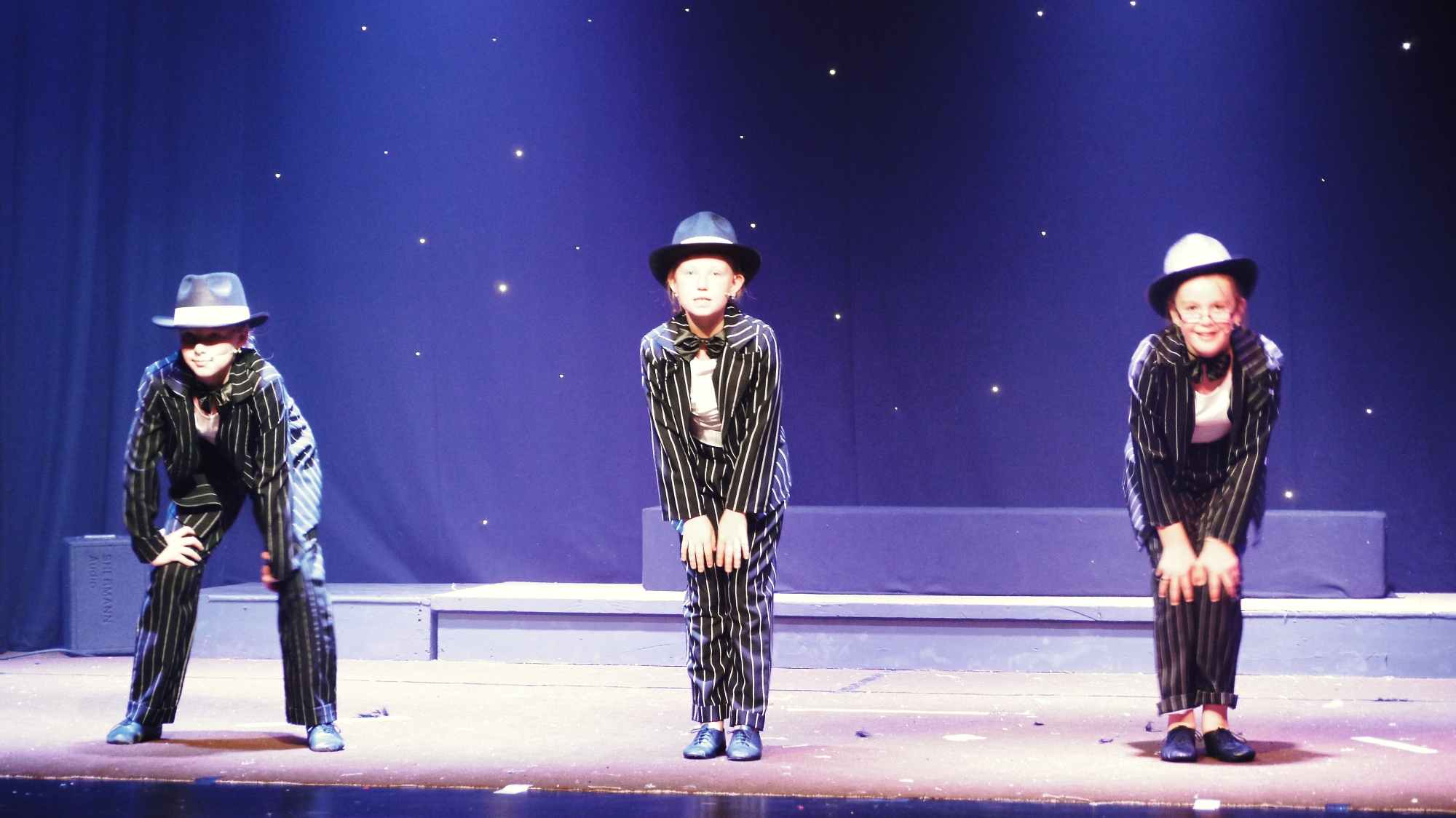 Alice Parr, Jessie Thomas and Lily Jones performing Bad Guys from Bugsy Malone.
