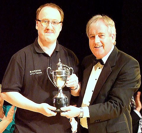 Neil Maidman being presented with the Welsh One Act Festival Trophy