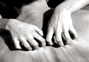 Tantric massage therapist scratching back